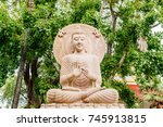 buddha statue sitting under... | Shutterstock . vector #745913815