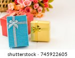 gift box with ribbon on white... | Shutterstock . vector #745922605