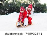 little girl and boy enjoy a... | Shutterstock . vector #745932541