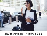 cheerful female manager getting ... | Shutterstock . vector #745935811