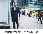 pensive businessman in formal... | Shutterstock . vector #745939255