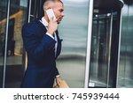 serious businessman leaving... | Shutterstock . vector #745939444