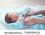 cute newborn baby girl in towel ... | Shutterstock . vector #745939921