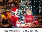children baking christmas... | Shutterstock . vector #745942045