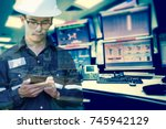 double exposure of  engineer or ... | Shutterstock . vector #745942129