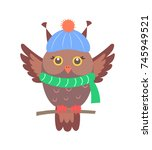 closeup of brown owl sitting on ...   Shutterstock .eps vector #745949521