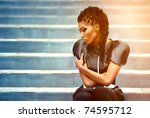 beautiful african woman sitting ... | Shutterstock . vector #74595712