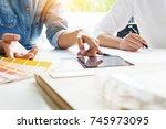 creative or interior designers... | Shutterstock . vector #745973095
