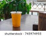 orange juice  in a plastic... | Shutterstock . vector #745974955