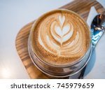 a cup of coffee in cafe. | Shutterstock . vector #745979659