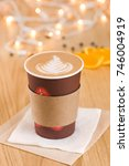 cappuccino in a takeaway cup on ... | Shutterstock . vector #746004919