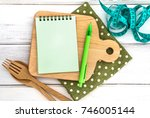 the  notepad on chopping board... | Shutterstock . vector #746005144