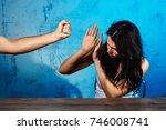 a man mocks a woman against a... | Shutterstock . vector #746008741