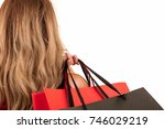 back view of woman carrying... | Shutterstock . vector #746029219