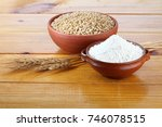 wheat grains and wheat flour on ... | Shutterstock . vector #746078515