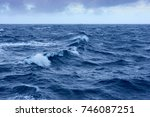 clouds  waves and ship trace in ... | Shutterstock . vector #746087251