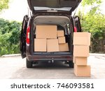 open car trunk and moving boxes ... | Shutterstock . vector #746093581