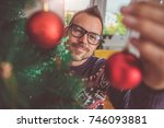 men wearing blue sweater and... | Shutterstock . vector #746093881