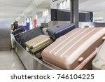 wheeled suitcase on a luggage...   Shutterstock . vector #746104225