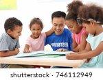 young male volunteer reading... | Shutterstock . vector #746112949
