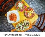 a summer dinner .pasta   pizza  ... | Shutterstock . vector #746122327