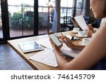 business lady using her... | Shutterstock . vector #746145709