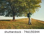 man is watching nature with...   Shutterstock . vector #746150344