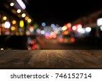 empty dark wooden table in... | Shutterstock . vector #746152714