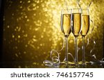 picture of three glasses with... | Shutterstock . vector #746157745