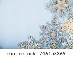 silvery snowflakes on a blue...   Shutterstock . vector #746158369