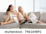 happy young women reading... | Shutterstock . vector #746164891