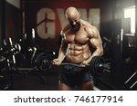 shot of a shirtless muscular... | Shutterstock . vector #746177914