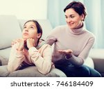 young mother persuades daughter ... | Shutterstock . vector #746184409