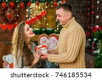 boyfriend gives girlfriend... | Shutterstock . vector #746185534