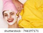 joyful woman with a towel... | Shutterstock . vector #746197171