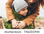 mother and son embracing... | Shutterstock . vector #746201944