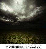 Dark Storm Clouds Over Meadow...