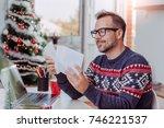 men wearing blue sweater and... | Shutterstock . vector #746221537