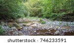 mountain river in the forest.... | Shutterstock . vector #746233591