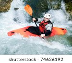 An Active Kayaker On The Rough...