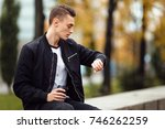 young boy look at his watch and ... | Shutterstock . vector #746262259