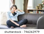 Small photo of Close up beautiful young asian woman short hair relaxation by side the window in living room at home