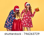 christmas. two young woman and... | Shutterstock . vector #746263729