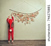 child  in pajamas and christmas ... | Shutterstock . vector #746270881