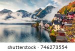 foggy autumn scene of hallstatt ... | Shutterstock . vector #746273554