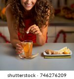 happy young woman putting brown ...   Shutterstock . vector #746276209