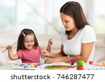 mother and daughter together... | Shutterstock . vector #746287477