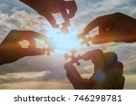 collaborate four hands trying... | Shutterstock . vector #746298781