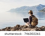 young woman using laptop... | Shutterstock . vector #746302261