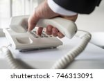 businessman dialing a telephone ... | Shutterstock . vector #746313091